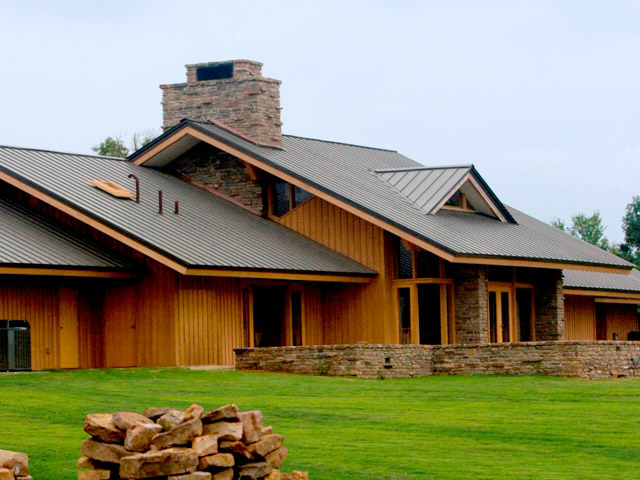new metal roofing on large cedar sided upscale suburban home