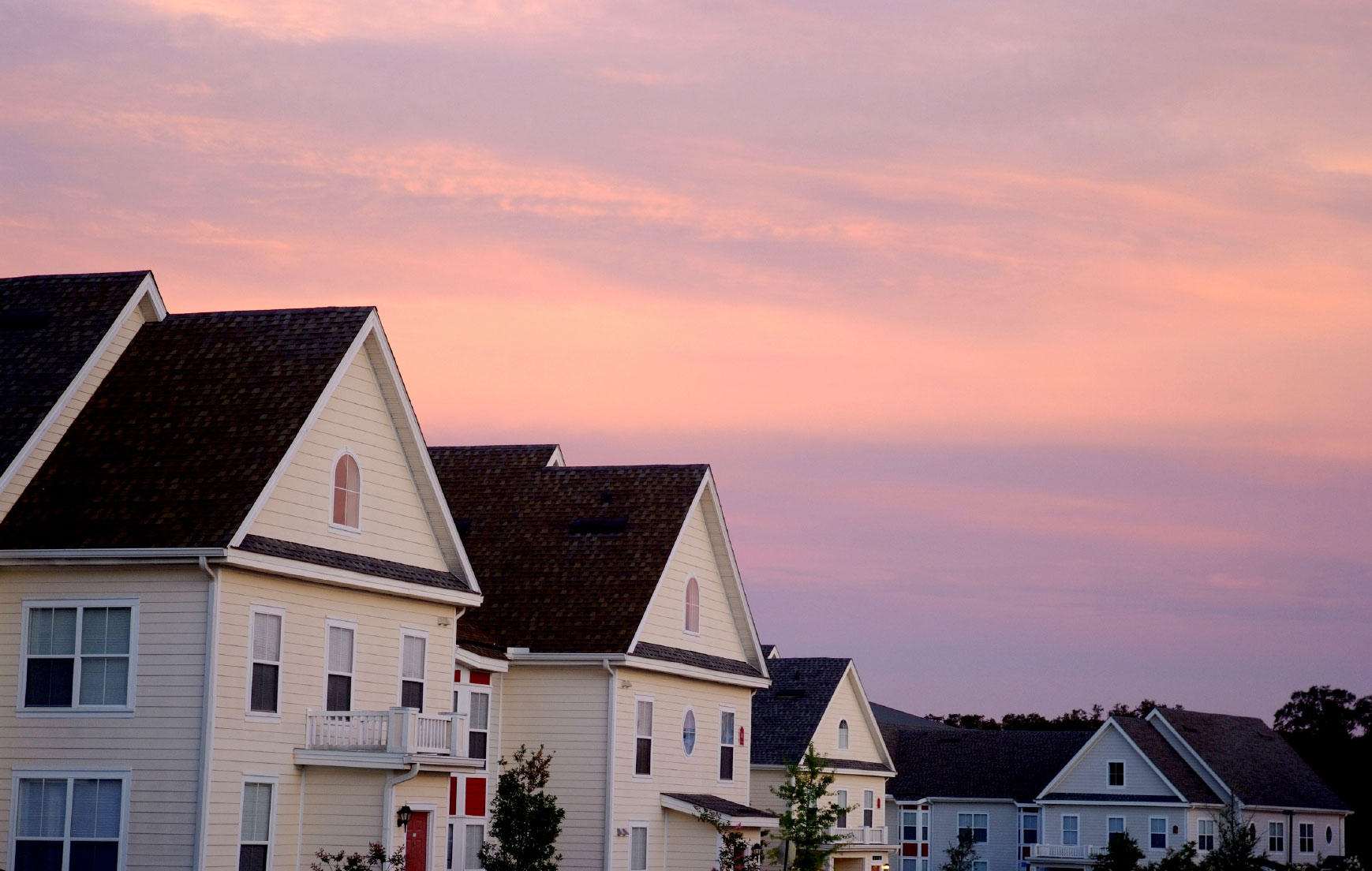 row of townhomes at sunset